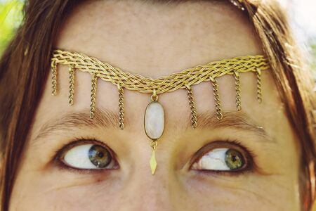 Closeup of young womans head wearing romantic metal tiara on her forehead