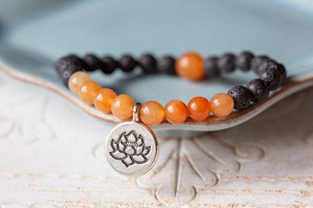 Lava and carneol mineral stone beads bracelet with lotus pendant