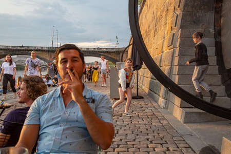 Prague, Czech republic, June 13, 2020: Prague Vltava waterfront, people enjoying sunset time at the quay Sajtókép