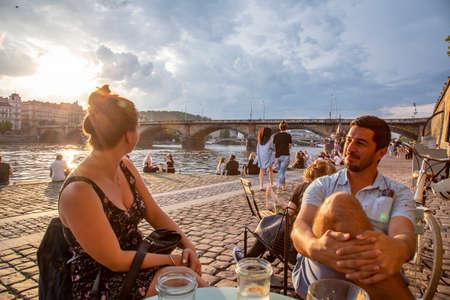 Prague, Czech republic, June 13, 2020: Prague Vltava waterfront, people enjoying sunset time at the quay Sajtókép
