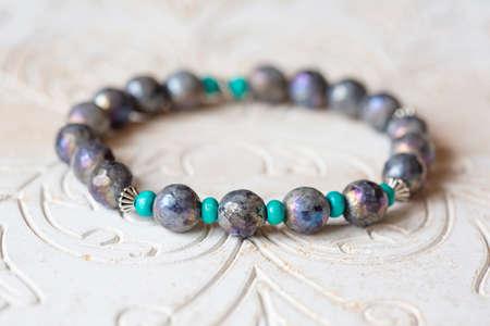 Mineral stone bracelet on white decorative background Stock fotó