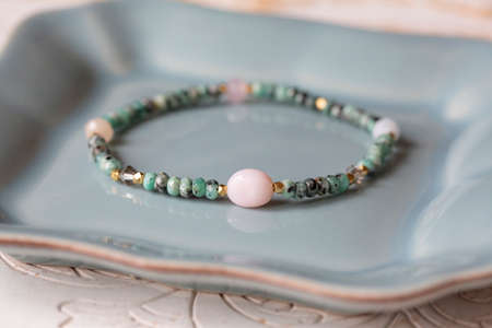 Mineral stone bracelet on white decorative background Stock fotó