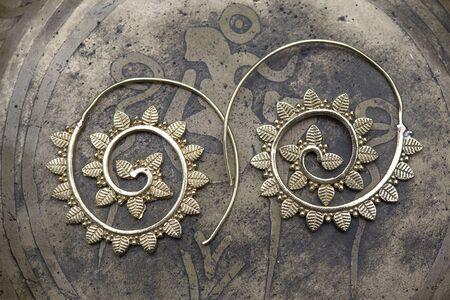 Brass metal boho style Indian earrings  Stock fotó