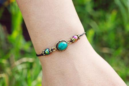 Mineral stone tyrkys pendant bead bracelet on female wrist