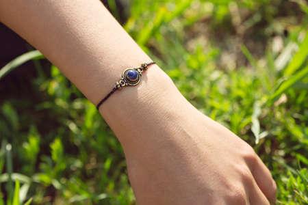 Mineral stone lapis lazuli pendant bead bracelet on female wrist