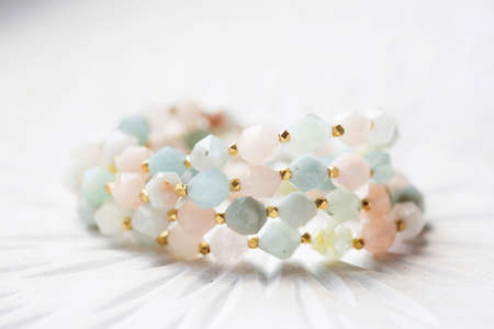 Cubic faceted morganite mineral stone beads bracelet on white background