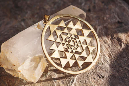 Decorative spiritual sacred pendant on neutral natural background