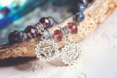 Fifth chakra symbol pendant bead bracelet