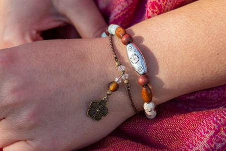 Female hand wearing mineral stone beads bracelets