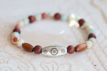 Mineral stone beads yoga bracelet on neutral natural background