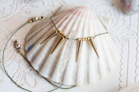 Beautiful mineral stone and metal components necklace on white shell