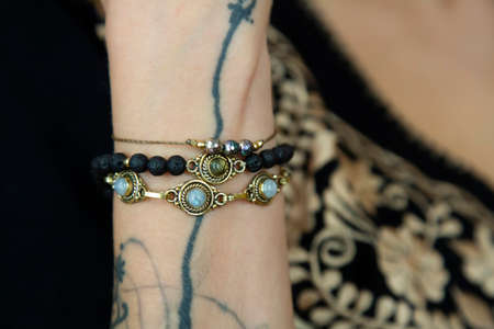 Girl wrist detail wearing collection of bracelets 版權商用圖片