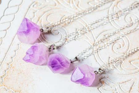 Amethyst raw stone pendant on silver chain 版權商用圖片