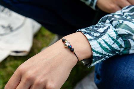 female hand wearing tiny gemstone bracelet 版權商用圖片