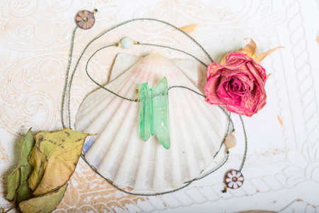Crystal quartz jewelry necklace on white shell background