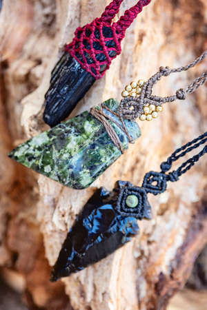 Black natural mineral stone jewelry necklace on natural background