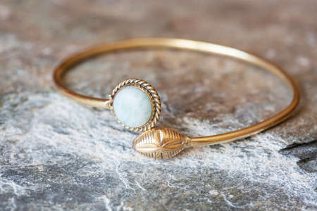 Brass bracelet with mineral gemstone decorative detail for woman Foto de archivo