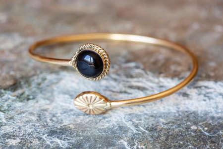 Brass bracelet with mineral gemstone decorative detail for woman Archivio Fotografico