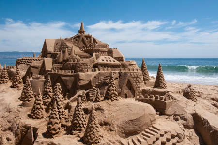 Sand castle on a beach in Reñaca, Chile. Sand castle on the Chilean coast on the shore of the Pacific Ocean. Photo with Horizontal Orientation