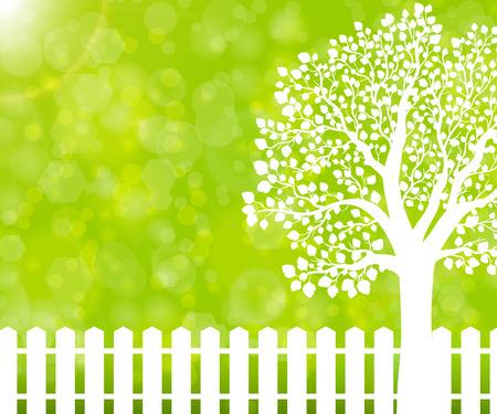 Groene natuur achtergrond met tuinomheining en boom