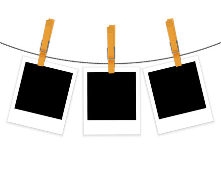 Photo frames on rope with clothespins background