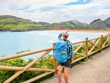 Lonely Pilgrim with backpack walking the Camino de Santiago in Spain, Way of St James 版權商用圖片 - 98923561