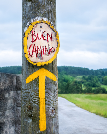 Yellow arrow, sign for pilgrims on the Camino de Santiago in Spain, Way of St James