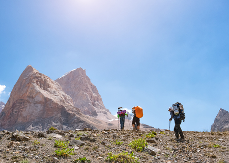 Group of backpackers hiking in Fann mountains. Tajikistan, Central Asia