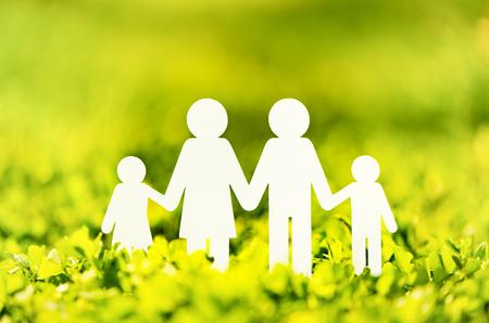 Paper family on green grass background 版權商用圖片