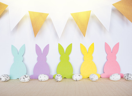 Easter background with eggs, rabbits and garland flags Stock Photo