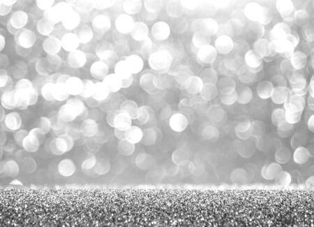 Abstract glitter silver background. Holiday shiny texture. Winter xmas theme Stock Photo