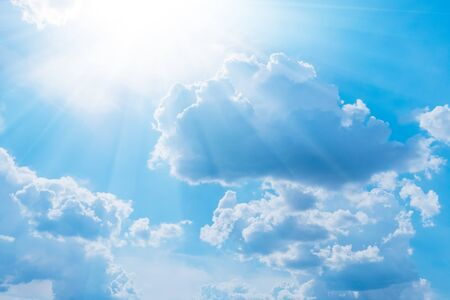 Blue sky with white clouds and sun. Nature background