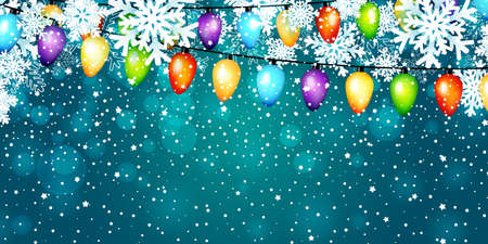Christmas light bulbs garlands and paper snowflakes on blue