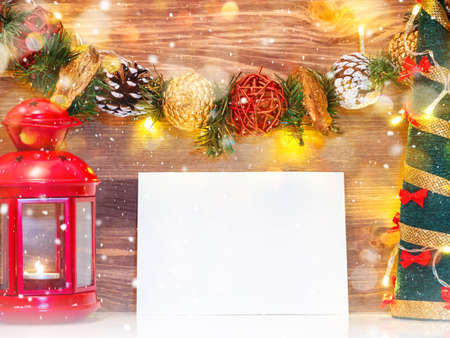 Christmas background with paper blank and christmas decorations