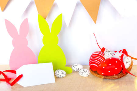 Easter background with eggs, rabbits and garland flags Banco de Imagens