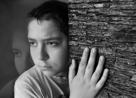 young boys: sad boy Stock Photo