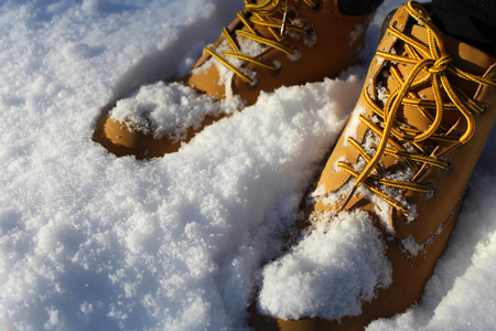Boots in the snow Imagens
