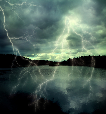 water reflection: Storm cloud with lightning on the forest lake