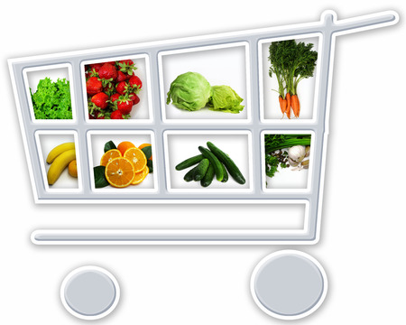 Shopping cart with groceries on white background. Banco de Imagens