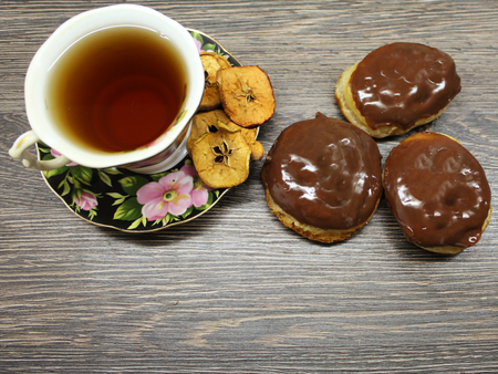 Homemade brownies and a cup of tea with dried fruits. Stock Photo