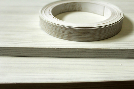 Chipboard. Plastic and paper edge wrapping of furniture