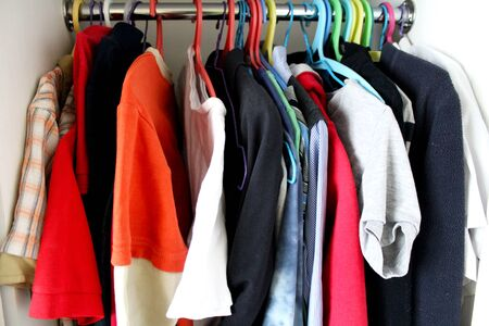 Wardrobe with clothes as background image. 스톡 콘텐츠