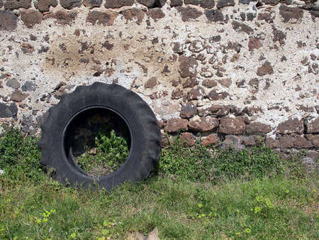 pneu: Wall in Spain, black tractor tyres abandoned