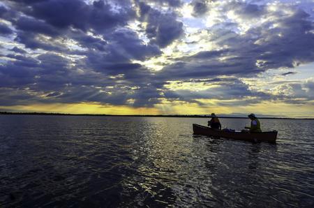 georgian: Canoeists paddling into sunrise