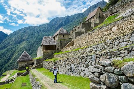 Tourist in Machu Picchu, the Lost City of the Incas, Peru Stock Photo