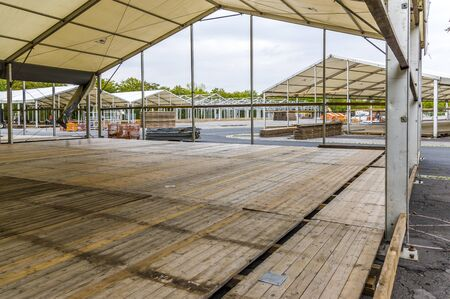 Exhibition construction of a regional fair, tent construction, aluminum poles and squared timber for tent floor in the fair tents, view over the exhibition grounds Standard-Bild