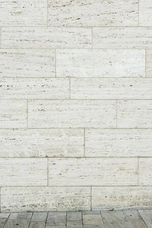 Travertine facade as background with a small piece of travertine stone floor