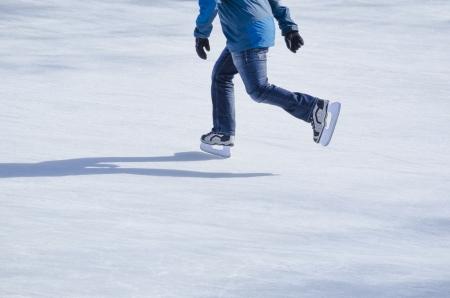 ICE RINK: Man skating on a frozen lake