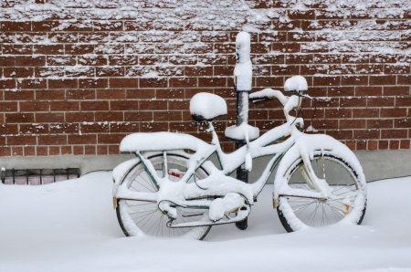Bike covered with fresh snow in Montreal photo