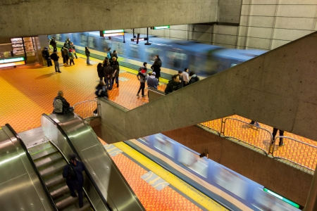 Passagers in Montreal subway, while two trains arrive